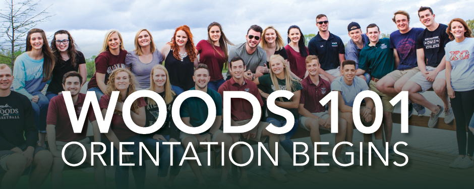 Woods 101: Orientation Begins - Shows a group of students smiling for a photo