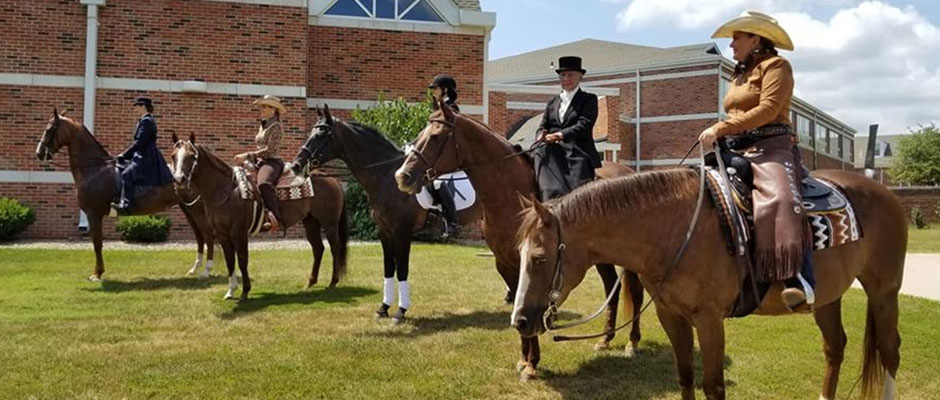 Equestrian instructors atop horses