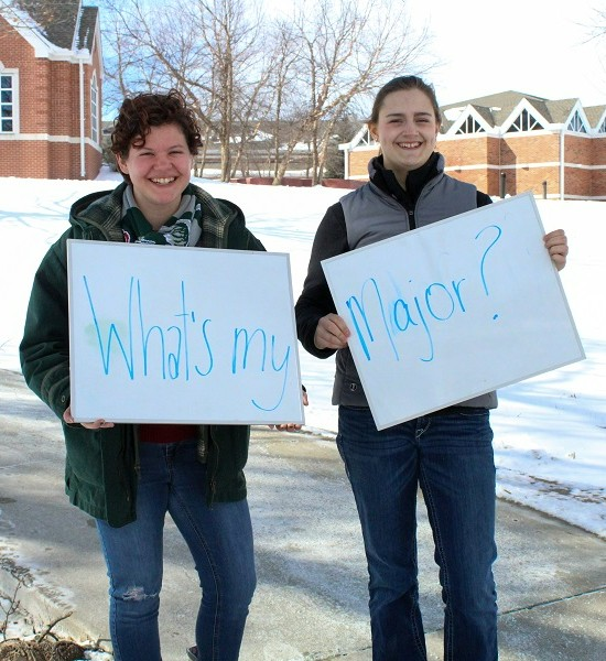Students posing with a sign reading What is my Major?