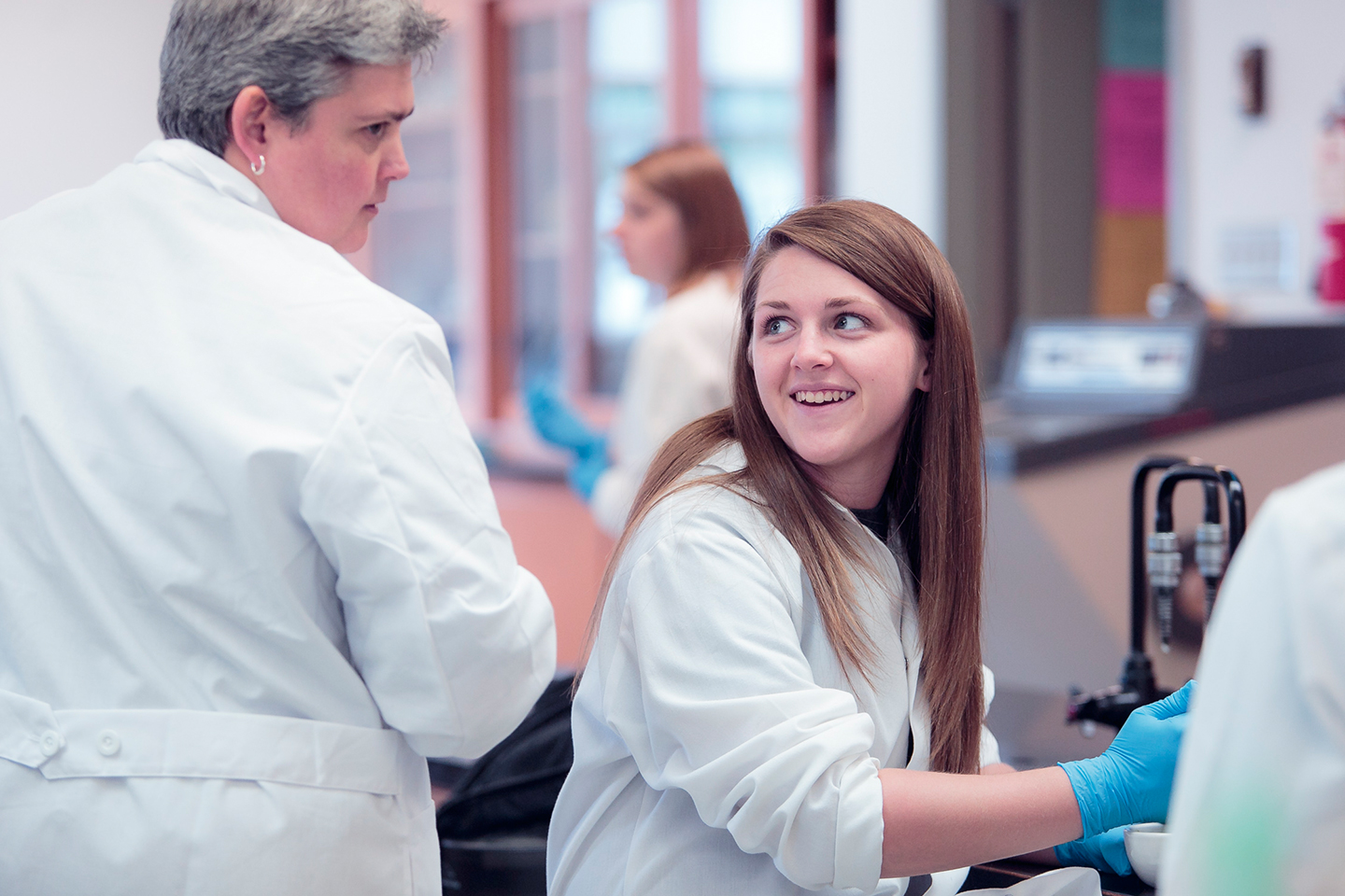 Why is laboratory important in biology in conjunction with biology courses?